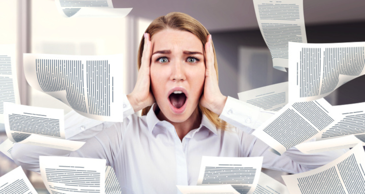 Stressed blonde businesswoman crying with horror standing in her office with documents flying around. Paperwork overload concept. Double exposure